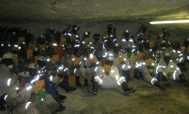 Xtrata Mine workers with a copy of HIV & AIDS